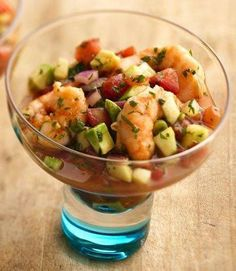 """Ceviche is a Latin American dish where fish is """"cooked"""" by marinating it in citrus juices. This hybrid recipe takes that concept and applies it to shrimp cocktail, adding in avocado, cilantro, chiles and spices. Since this appetizer needs to marinate for a couple hours, it's a great make-ahead dish for your next party!"""