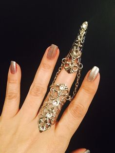 Items similar to Armor ring and claw ring, made in silver color filigree metal,adorned with clear crystals, its sizable. Hand Jewelry, Metal Jewelry, Jewellery, Steampunk Nails, Nail Guards, Full Finger Rings, Armor Ring, Nail Ring, Unusual Jewelry