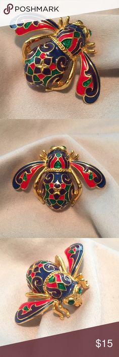 """Joan Rivers Enameled Imperial Bee Pin This beautiful goldtone enamel bee brooch is sure to generate a lot of buzz. Green crystal eyes contrast nicely with the body's ornate design of blue, purple, green and red epoxy enamel. Measures approximately 1-1/8""""L x 1-5/8"""" Joan Rivers Other"""