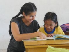 Our volunteer Harpreet is helping her student with a reading excersice