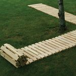 Temporary walkway that rolls up when not in use. Brilliant!!  It looks kinda like the Ikea bed slats. Hmmm...