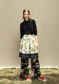 Model wears Naughty Dog SS17 black shirt, a butterflies & flowers print skirt with a contrasting stars print at the bottom and a pair of floral print palazzo pants.
