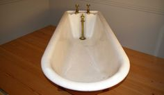 Reclaimed cast iron roll top plunger bath