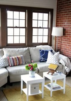 small living room with brick wall