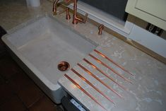 Copper Kitchen Dish Drainboard, Faucet with Sprayer and Sink Drain with Concrete Countertop and Concrete Farm Sink Portfolio: Kitchen ~ Bonehead Structure