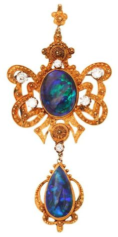 1950's Etruscan Revival Australian Black Opal Diamond Brooch / Pendant frame centrally set with two black opals framed with 6 European cut diamonds, in a handmade 22k yellow gold mounting with applied gold bead accents.