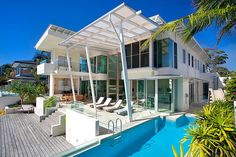 Designed by Carole Tretheway Design, this contemporary ocean side holiday home is situated in Noosa Heads, Queensland, Australia.