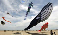 Several kites fly over Malvarrosa beach as part of 17th International Kite Festival in Valencia, eastern SPAIN, 26 April 2014. Some thousand people take part in the festival running from 25 to 27 April. (EPA/JUAN CARLOS CARDENAS)