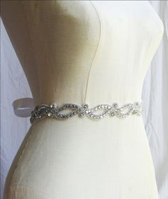 Sparkling crystals are edged with silver beading in this open-pattern sash.