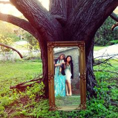 I'm not sure if we want to haul a mirror to the park, but we should definitely pose in front of some trees!