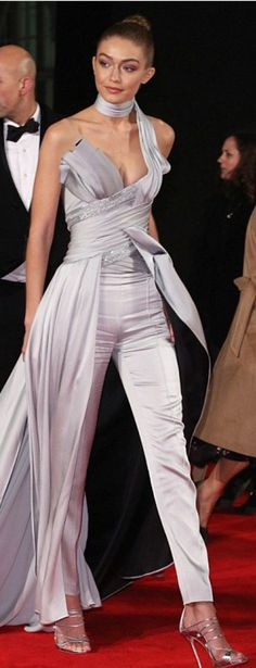 Who made  Gigi Hadid's gray one shoulder top, pants, and silver sandals?
