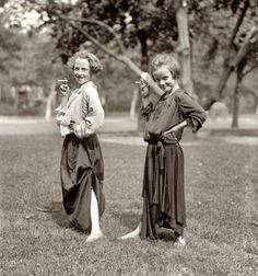 August 31, 1923 Girls dressed as adults, posing with cigarettes
