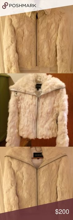 Beautiful GUESS Rabbit Fur White Jacket. New This beautiful authentic Guess fur jacket has never been worn. The jacket is made of 100% genuine super soft white rabbit fur and trimmed in white leather. It features two side slash pockets, a zip up front, and it is lined in white satin. It has been stored in a protective garment bag in a temperature controlled closet to protect and preserve the fur. The jacket is in perfect condition, never worn but I did remove the tags upon purchase. The…