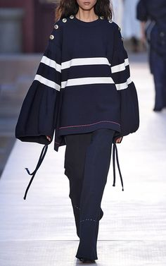 """The Designer: Creative Director since 2014, Julie de Libran continues to channel the house's trademark Parisian self-confidence, each season reinventing Rykiel icons such as stripes,    knitwear and denim.  <br><br> This Season It's About: Madame Rykiel. The show was a moving tribute to the late designer, complete with a lineup of alphabet sweaters that spelled out    """"Rykiel Forever."""""""
