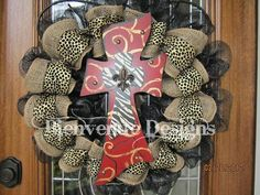 Leopard print, zebra print, fleur de lis, and a cross. This need to be on our door @lisa!
