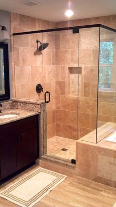 Seamless glass shower with beautiful tile and bronze fixtures