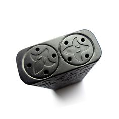 The Jester's Black Mask is a full deep engraved black matte aluminum box mod pack with power via dual 18 series battery configuration and silver plated contacts. The mod is limited, with only few pieces made.