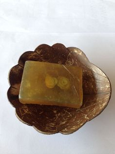 Coconut shell soap dish.Natural coconut shell dish. This unique and elegant soap saver dish is handmade from coconut and is designed to preserve your