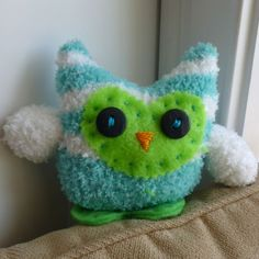 Owl made out of an infant fuzzy sock.
