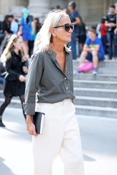 Half button up gray shirt, white trousers + black summer sunglasses
