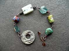 I love this type of CLASP! (https://www.etsy.com/listing/174759904/pine-copper-trade-beads-roman-glass)