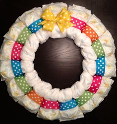 Custom Personalized DIAPER WREATH Baby Shower Gift Decoration BRIGHT Multi-Color Boy or Girl Unisex Gender Neutral Initial. $35.00, via Etsy.