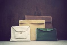 leather purses of different colors and texture