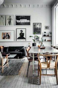Gorgeous gallery wall - mainly black and white - in a stunning room, also mainly black and white. I like how the odd touch of natural wood tones appears so subtly. #photogallerywall #photowall #b&wdesign
