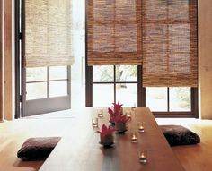 This calm space features woven wood Roman shades from Dania Beach, FL-based Total Window.