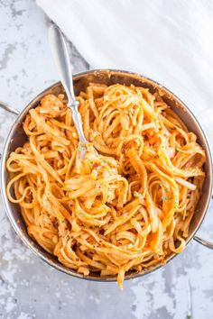Slow Cooker Firecracker Chicken Pasta  For less spicy use less hot sauce and less hot peppers.