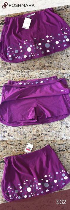 NWT Nike Running Skort Size L NWT Nike Running Skort Size Large. Purple Skort with attached shorts, 92% polyester, 8 % spandex. Nike Skirts