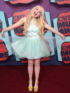 Who's Having the Most Fun at the CMTs? | TAKE A BOW  | She's tutu cute! Former The Voice contestant RaeLynn shows off her love of pastels on the red carpet.