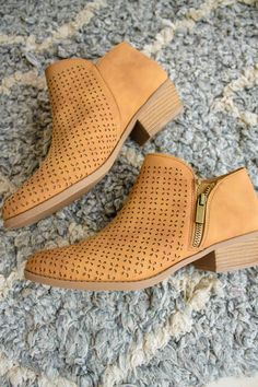 Braxton Perforated Bootie A beautiful perforated low bootie, the Braxton bootie is definitely one of our favorites! Easy to wear with a zip side closure and perforated details to make you stand out! This beautiful tan color looks great with so many outfits! Available in 5.5, 6, 6.5, 7, 7.5, 8, 8.5, 9, 10