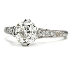 You simply MUST click on this ring to appreciate all the details.  Stunning.    Your dreams will come true with this Edwardian era diamond ring. Elegant and sophisticated on the hand, an old European cut diamond of 1.22 carats (G-H color; VS2 clarity) is set within an exquisite platinum mount. Surrounded on each side with two (2) old European cut and two (2) single cut diamonds, the entire matrix of the ring becomes an amphitheater of prismatic light.