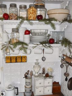 Decorate for Christmas with evergreen branches and apples for a pop of color