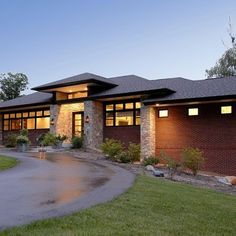 Prairie style home is uniquely American, including strong horizontal lines, and includes vertical casement windows in groups.