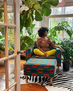 "Stacey-Ann Blake on Instagram: ""When your sunroom is its own biome, and you want to add a touch of West Africa, you look no further than the new Ẹkáàbọ̀ Collection in…"" Biomes, West Africa, Tropical Plants, Plant Decor, You Look, Sunroom, Accent Chairs, Ann, Touch"