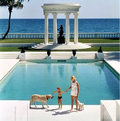1955 Slim Aarons - C.Z. Guest at her Palm Beach estate pool.