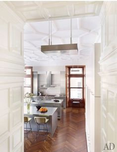A view of the kitchen and its plasterwork ceiling in a Boston home designed by Thad Hayes.Pin it.See how top designers and architects are decorating their dining rooms From bright lemon to rich saffron, discover beautiful yellow rooms from the pages of AD See the special board of holiday inspiration fashion designer Jenni Kayne is curating just for AD Follow AD on Pinterest for more beautiful spaces and intriguing design