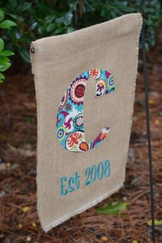 Love it!!! So cute and easy!!! Supersize a letter on word, trace onto back side of fabric, cut out, use iron on adhesive to stick the letter to the burlap, stitch in place. The adhesive keeps it from moving when sticking it down.