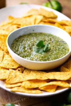 Easy recipe for homemade tomatillo salsa or salsa verde. Learn how to make the best restaurant style salsa verde right at home with simple ingredients.