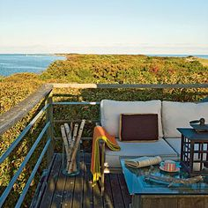 The steel-and-cedar railing on this rooftop terrace rises above even the tallest trees. | Coastalliving.com