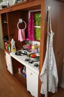 this uses an old entertainment center- I like the hook for the apron!
