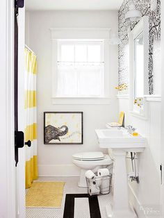 The pretty floor tiles stayed, but not much else. Vintage wood flooring inlaid among the hexagonal tiles echoes the floors in surrounding rooms and elongates the tiny bathroom. A sleek pedestal sink replaces the bulky built-in vanity of yesteryear, while a bold wallpaper pattern highlights an accent wall. Little bursts of yellow keep the space fresh and modern.