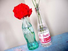 buy antique coca cola glass bottles and fill them with different, bright colored flowers & paste different pictures of Jen & Trent on them