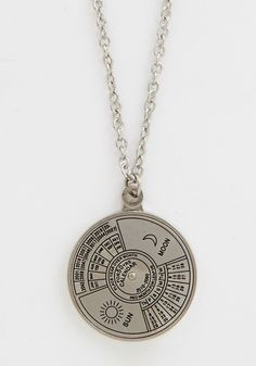 Spin Me Right 'Round Time Necklace. Glimpse into the fashionable future with this quirky silver necklace. #silver #modcloth