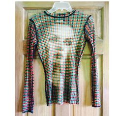 Jean Paul Gaultier Italian Mesh Sheer Top Jean Paul Gaultier Mesh Sheer Top with optical illusion face on from and back. Perfect condition. Green red and white pattern with a black seam outline. Price is not firm please use offer button Jean Paul Gaultier Tops Blouses