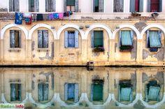 Chioggia (VE)  Windows reflections in a canal   Spiegelungen in einem der Kanäle.  More photos from Veneto   mehr Fotos aus Venetien: http://www.italien.info/regionen/venetien/Impressionen.aspx   Copyright © Klaus Rünagel