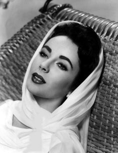 Elizabeth Taylor exudes Hollywood glamour with a classic headscarf. Channel the screen siren and try this look with your favourite #LilyandLionel Scarf.