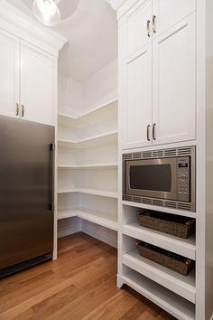 Walk-in pantry with freezer & microwave built-in by Veranda Estate Homes Inc. Calgary, Alberta